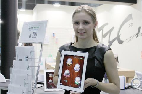 """智能手机和平板电脑2012:在R系统展位上展示使用FACETIME的在线口译服务""""TELTEL CONCITRY""""[报告]"""