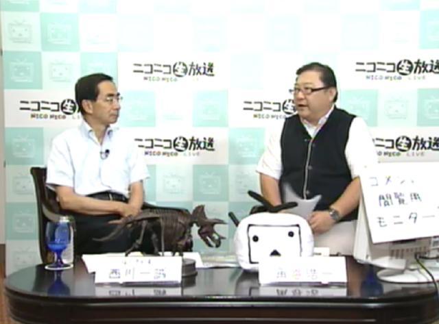 西川一誠福井県知事(左)と角谷浩一氏(右)
